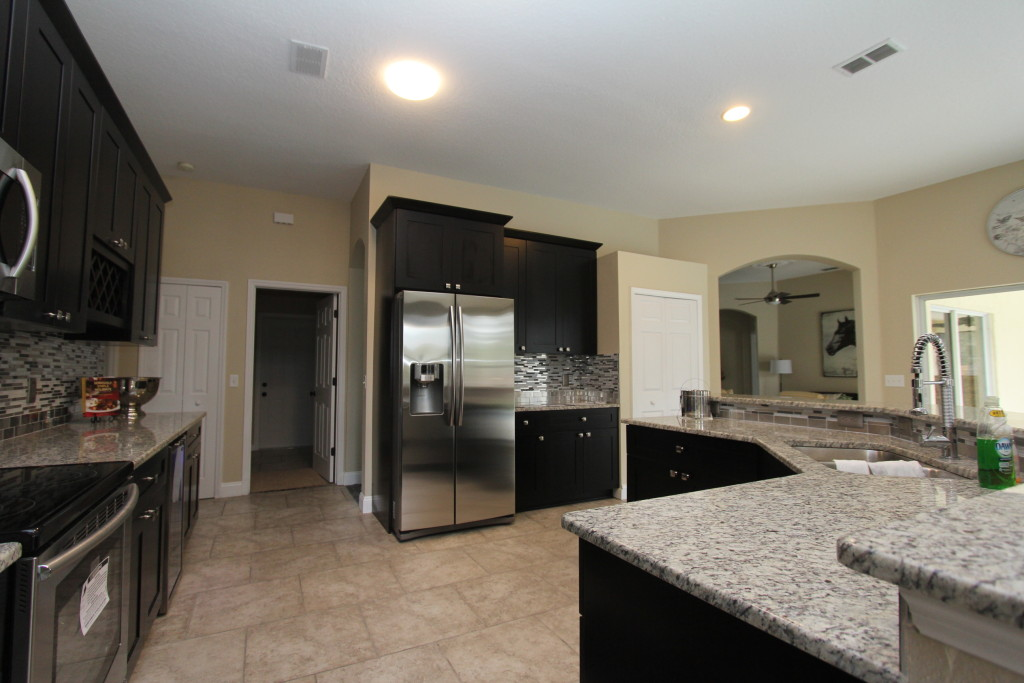 This kitchen just received new cabinets, counters and appliances. The layout remained the same
