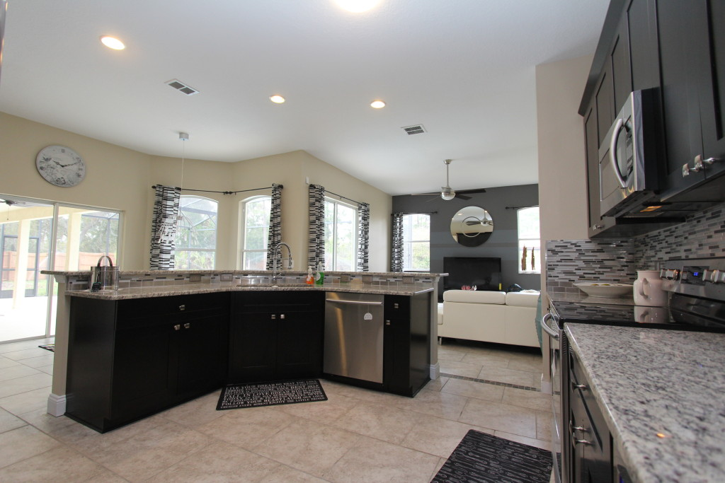 Dark walnut cabinets give a strong contrast