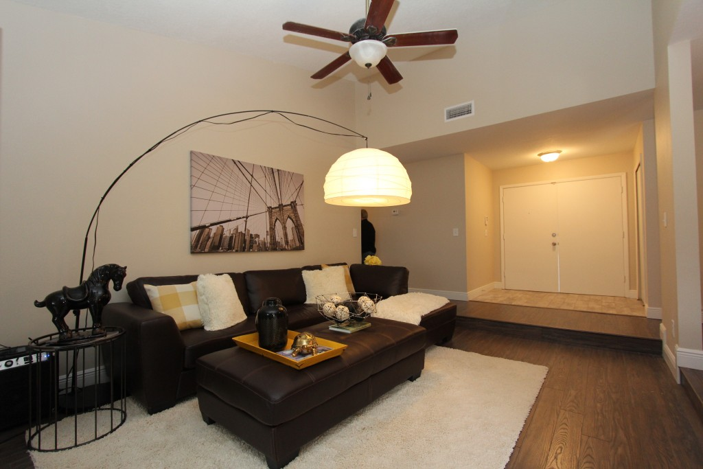 The living room was a good room to showcase a large sectional. Plenty of space here to offer ample seating for guests.