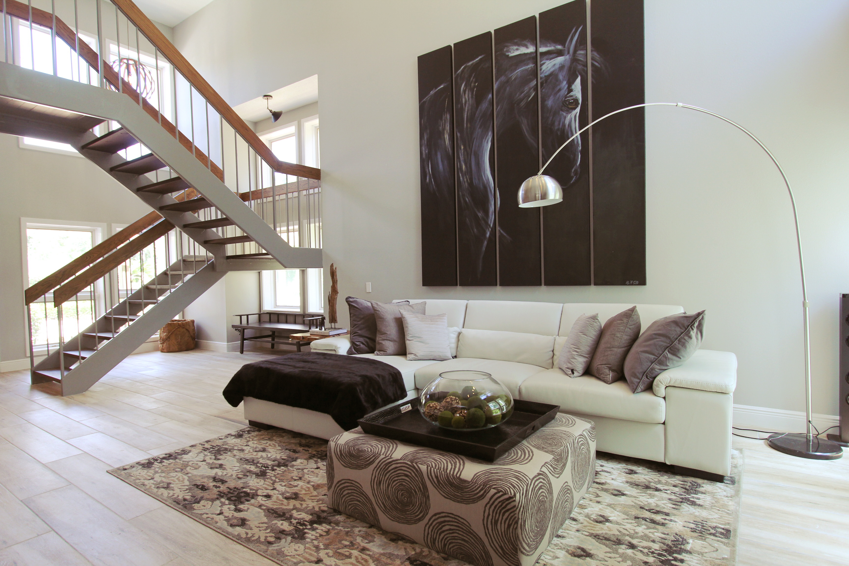 Sleek Lines And Larger Than Life Art Give This Grand Living Room Pizazz