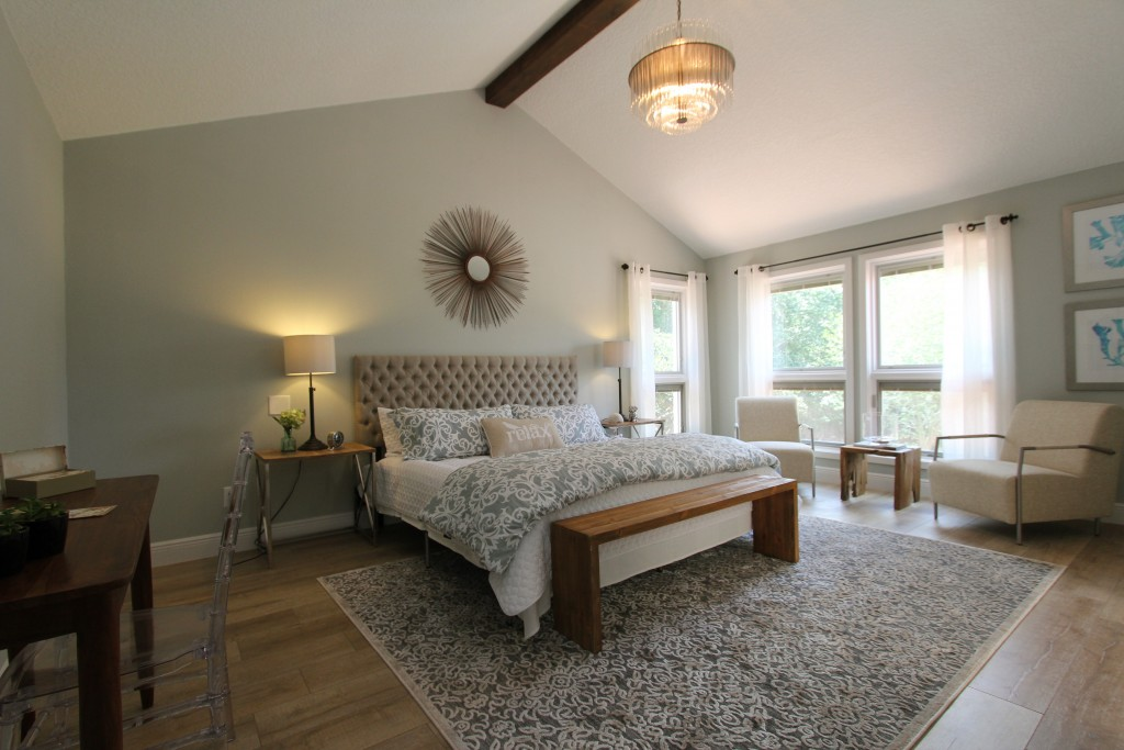 The Master bedroom with nice wood tones in a relaxing calming atmosphere