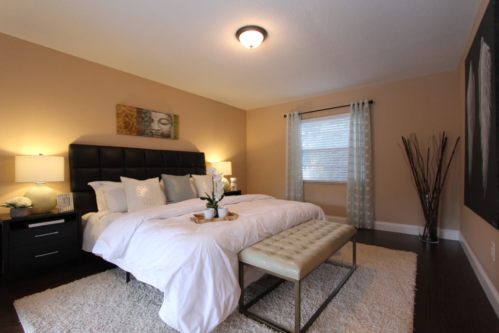 """""""After"""" the transformation we have an inviting master retreat. The king size bed gives reference to the space and shows its size."""