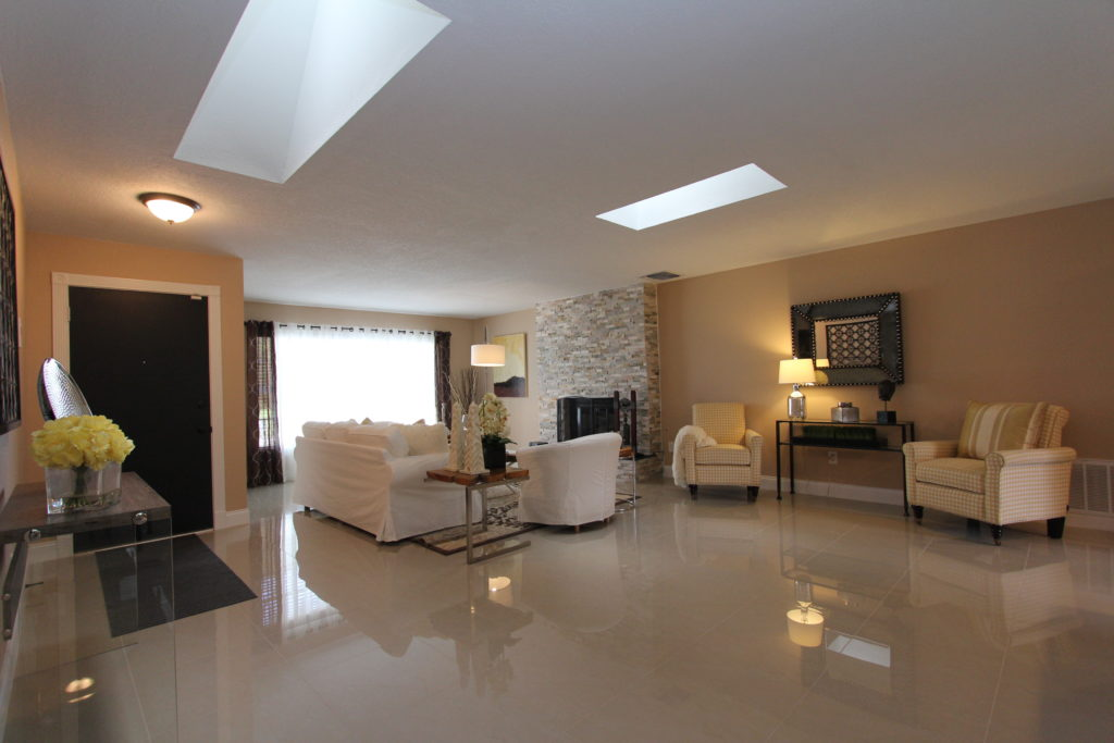 After the transformation we have definition through area rugs, extra lighting and an overall feeling of a living room