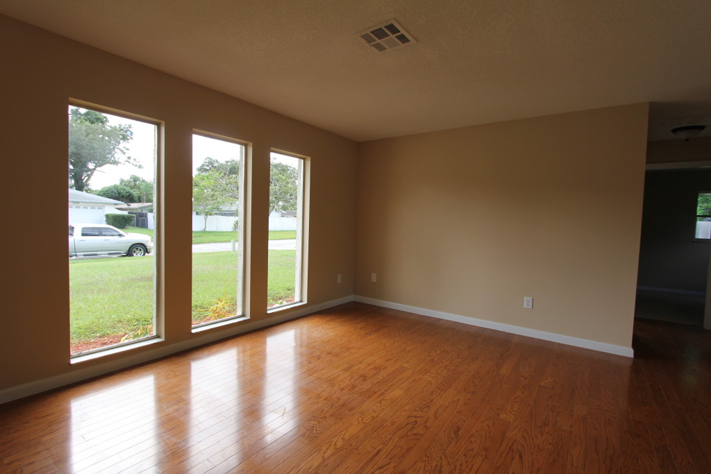 Before: The empty room looks small because it is missing furniture that helps the viewer grasp the scale of the space.
