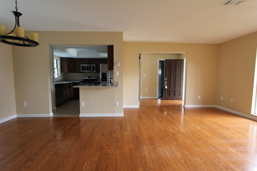 Before: Do we have a dining room? This empty space leaves question marks about the usability of the living area.