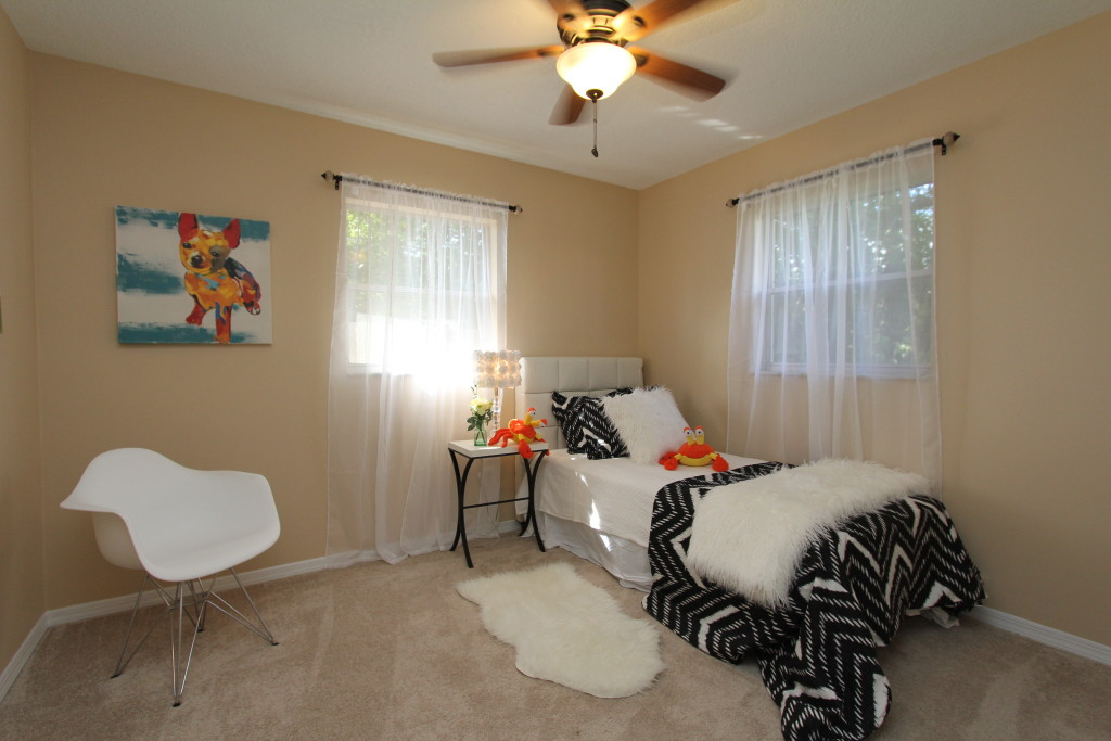 A twin bed and some kid friendly decoration will make this bedroom a hit.