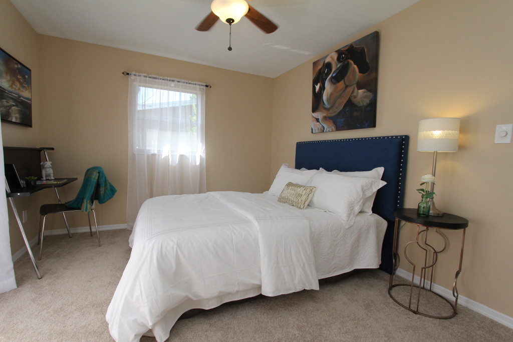 A cozy guestroom with a desk space, who does not want to come and visit here