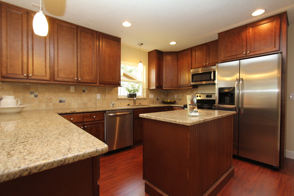 This kitchen offers granite counters, stainless steel appliances and plenty of cabinets